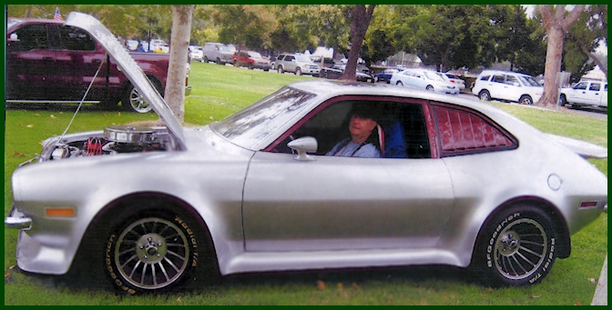 Jim Watson and his silver Ford Pinto Hatchback at a car show in Woodland Hills. Made with Mustang parts as well.