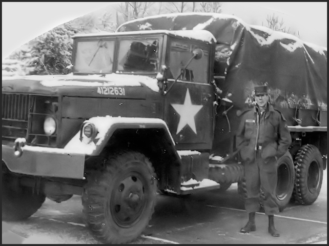 Jim standiing outside, 'Winter time' with his Truck. He was a mechanic in the Army.